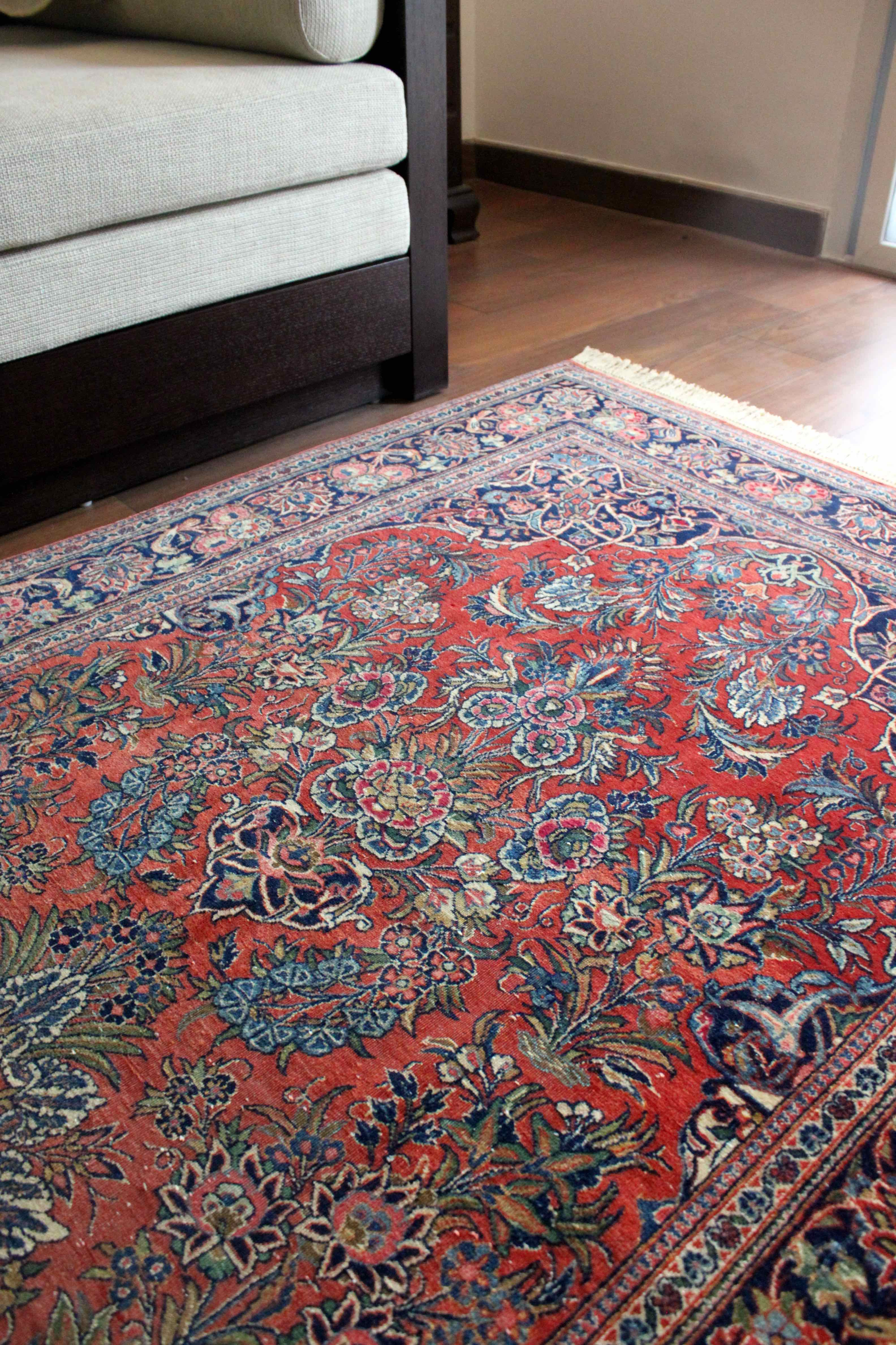An intricately decorated Kashan rug illustrates the role of carpets as art throughout history